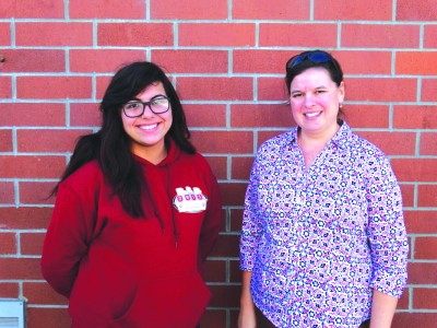 Norwalk High School junior Jennifer Sanchez, left, will play alto sax on New Year's day in the Pasadena City College Tournament of Roses Honor Band. She is pictured with band director Doris Doyon.