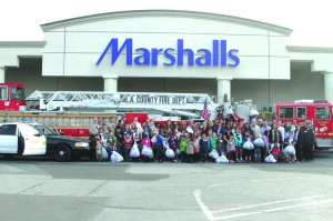 La Mirada students and volunteers stand outside Marshalls after members of the Rotary Club sponsored a shopping spree for local children in need. This year, 46 La Mirada children took part in the shopping spree and each child had a budget of $110 to spend at Marshall's on new clothing, jackets and shoes.