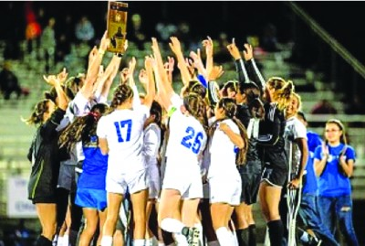 CHAMPS: The La Mirada High varsity girls soccer team celebrate a historic victory March 6 after clinching its first uncontested CIF Championship title.
