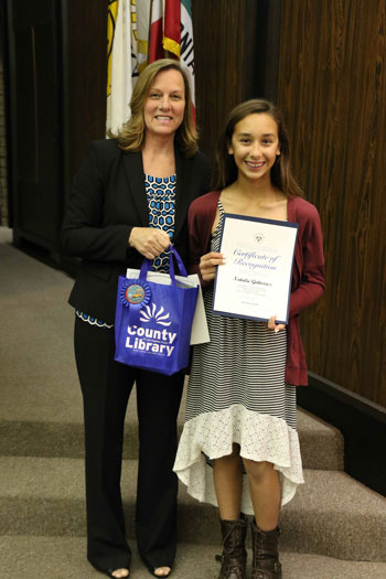 Mayor Deal presents a certificate to Natalie Gutierrez of Los Coyotes Middle School for First Place in her age group for the 2015 Bookmark Contest