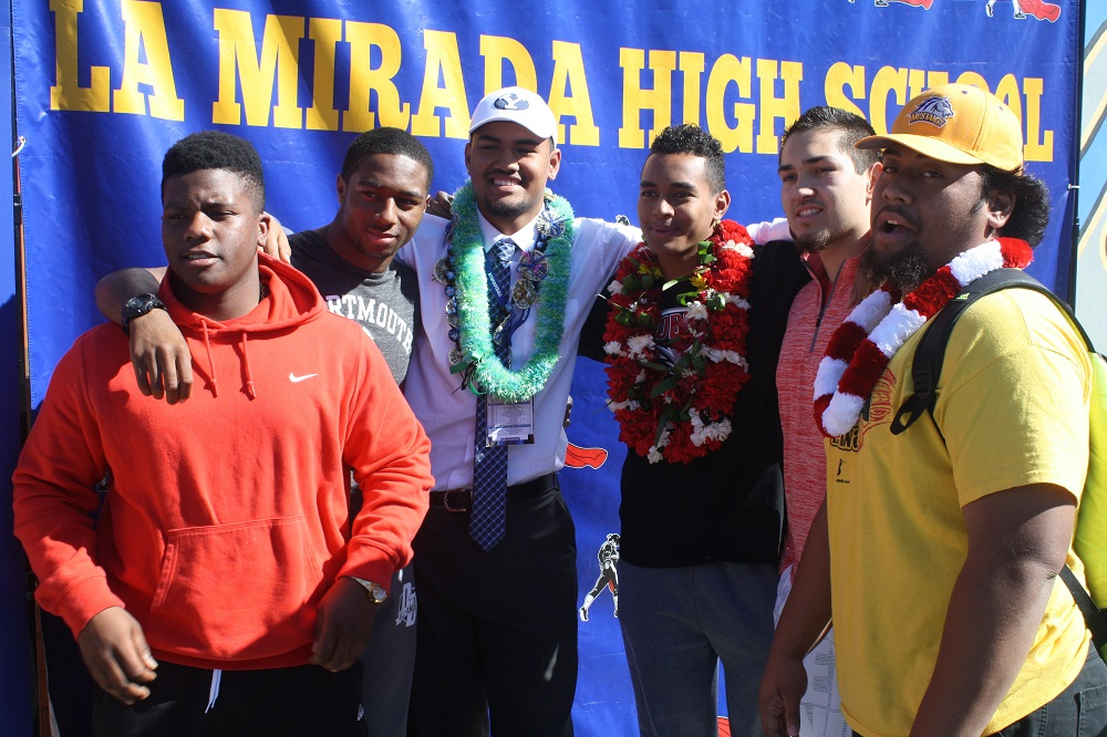 La Mirada High football Division III-AA State Championship teammates celebrate after signing official letters of intent. From L-R, Curtis Dixon, Micah Croom, Keanu Saleapaga, Tevaka Tuioti, Jared Enrico and Ty Faatoalia.