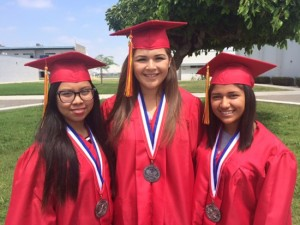 (From left to right) John Glenn High School graduates Kathleen Medrano, Destiny Enriquez and Monique Ramos pose at their commencement ceremony.