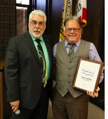 Mayor De Ruse presents Rabbi Mark Goldfarb of Temple Beth Ohr with a 60th anniversary recognition certificate at the August 23 City Council Meeting.