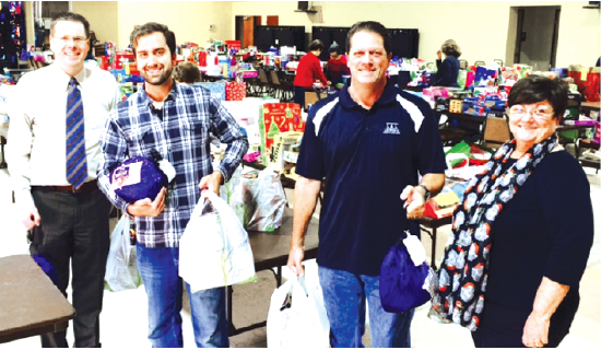 Members of the La Mirada Rotary Club donated more than $1,000 of complete holiday dinners for 34 families to the Good Sam Pantry at Beatitudes Church in La Mirada.  Pictured are (l to r): Russell Hall, Zurich Lewis, John Lewis and Pantry Coordinator Carmen Rawson.