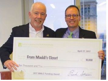 FIGHTING CHILDREN'S CANCER -- From Maddi's Closet was one of several non-profit organizations around the nation receiving funding from the Expect Miracles Foundation to support its fight against children's cancer.  Expect Miracles Foundation Board Member Jim Keenan (l) and Executive Director Frank Heavey presented the $10,000 check during recent ceremonies in Boston.