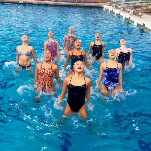 La Mirada Aquabelles Synchronized Swimming Team jumps for joy after completing competing in the 2015 Synchronized Swimming Junior Olympics.